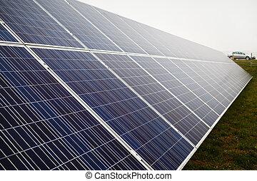 Photovoltaic solar farm - Solar panel on a cloudy day....