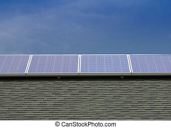 Photovoltaic Solar Panels Mounted on Roof with Blue Sky...