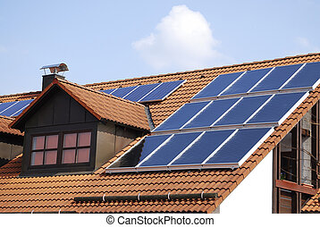 Photovoltaic - House roof with a photovoltaic system
