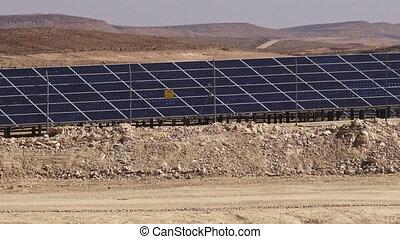 Photovoltaics in desert solar power farm in the Negev...