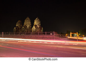 Phra Prang Sam Yot temple at night, architecture in Lopburi,...