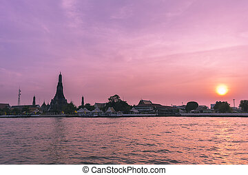Phra Prang Wat Arun, The beautiful temple along the Chao Phraya river at sunset in Bangkok, Thailand
