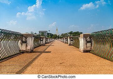 Phra That Nong Bua. - The bridge across the lake in a park...