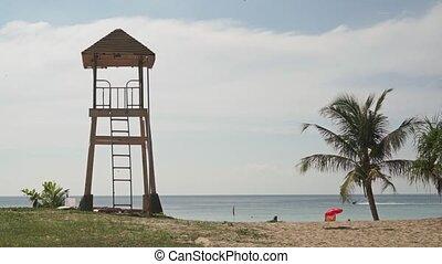 Phuket beach rescue tower, palm tree and jet ski