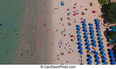 PHUKET, THAILAND - 20 JAN 2017: Lot of deckchairs are on beach near sea at summer sunny day
