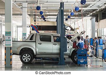PHUKET, THAILAND - MARCH 10 : Car technician repairing car...