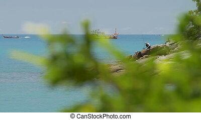 PHUKET, THAILAND - November 18, 2012. Men fishing on the...