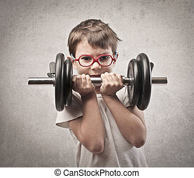 physical effort - small child with weights in hand on gray...