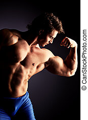 physical force - Portrait of a handsome muscular bodybuilder...