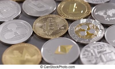 Physical metal cryptocurrency on a dark background. Digital...