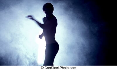 Physical Prowess - Slow motion of male silhouette performing...