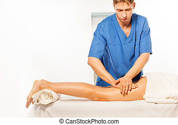 Physical therapist doing massage on woman hip