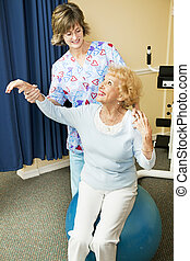 Physical Therapist Helps Senior Woman - Physical therapist ...