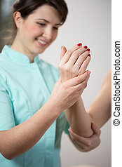 Physical therapist training upper limb of ill patient