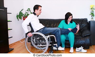Physical therapist with patient - Physical therapist working...