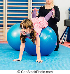 Physical therapist working with little girl