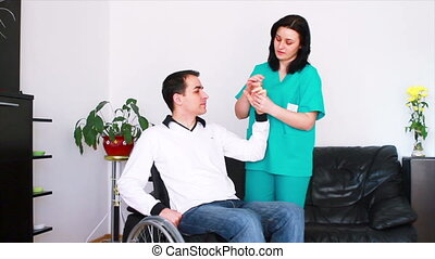 therapist working with patient - Physical therapist working...