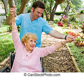 Physical Therapy Fun - Senior woman enjoys working out with...