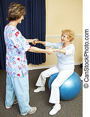 Physical Therapy Workout - Physical therapist using pilates...