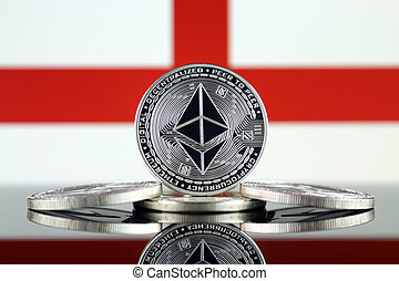 Physical version of Ethereum (ETH) and England Flag. ...