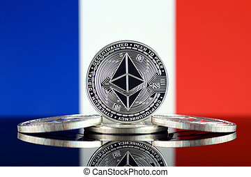 Physical version of Ethereum (ETH) and France Flag. ...