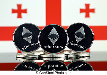 Physical version of Ethereum (ETH) and Georgia Flag. ...