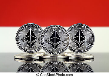 Physical version of Ethereum (ETH) and Indonesia Flag. ...