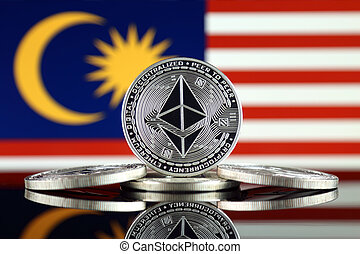 Physical version of Ethereum (ETH) and Malaysia Flag. ...