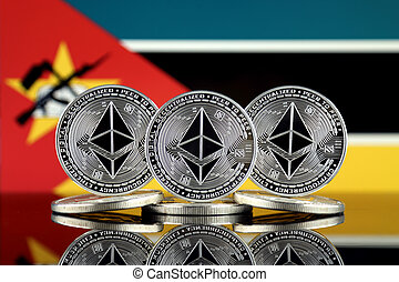 Physical version of Ethereum (ETH) and Mozambique Flag. ...