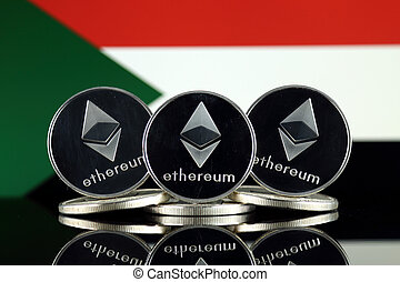Physical version of Ethereum (ETH) and Sudan Flag. ...