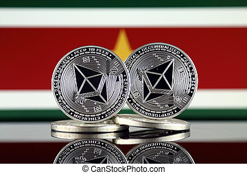 Physical version of Ethereum (ETH) and Suriname Flag. ...
