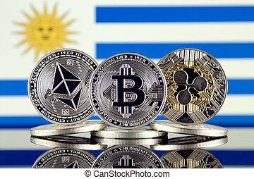 Physical version of Ethereum (ETH), Bitcoin (BTC), Ripple (XRP) and Uruguay Flag. The Top 3 Cryptocurrencies by Market Cap.