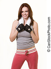 Physical workout - Attractive auburn haired woman in workout...