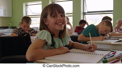 Physically challenged girl smiling in the class