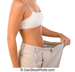Weight Loss - Physically Fit Woman Showing Off Weight Loss
