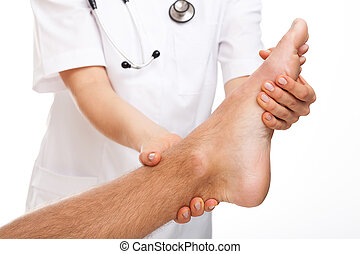 Female physician examining foot on white isolated background