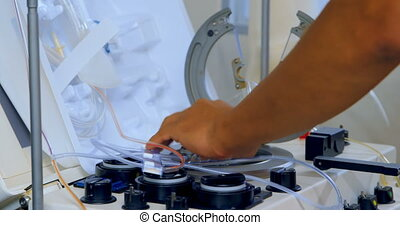 Physician removing medical equipment 4k - Physician removing...