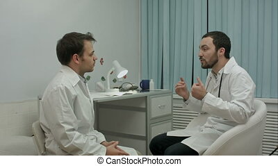 Physician tells to young intern about their medical center