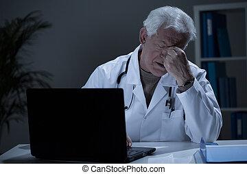 Physician with headache