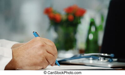 Physician writing medical prescription and shaking hand,...