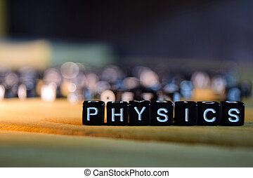 PHYSICS concept wooden blocks on the table.