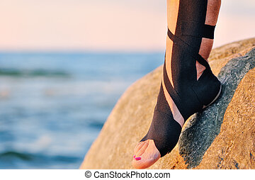 Physio tape - Therapeutic treatment of leg with black physio...