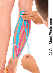 A picture of a special physio tape put on an injured calf over white background