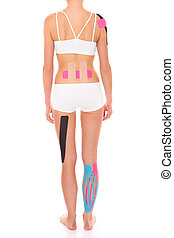 Physio tape treatment - A picture of the back of a woman...