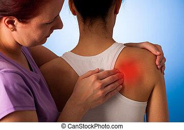 physio therapist helping Woman having pain in her back -...