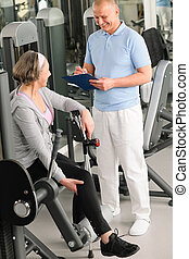 Physiotherapist assist active senior woman at gym - Physical...
