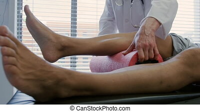 Physiotherapist at work in a hospital - Front view mid...