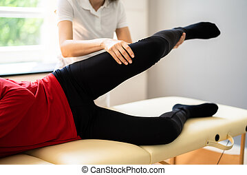 Physiotherapist Doing Thigh Rehabilitation Massage