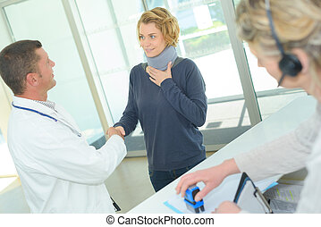 physiotherapist interacting with patient in clinic