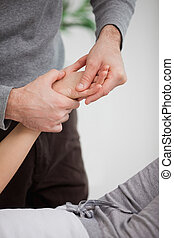 Physiotherapist massaging the hand of a patient